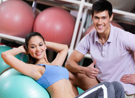 Athlete woman exercises in fitness gym with couch photo