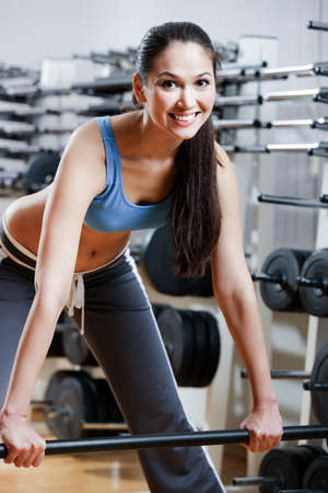Athletic woman with dumbbells in sport centre Stock Photo - 15177369
