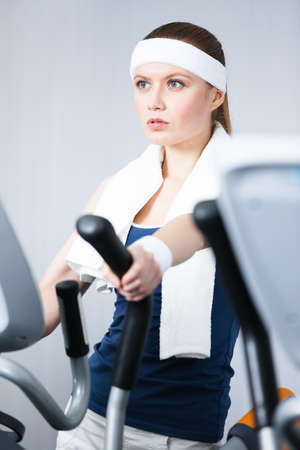 keep fit: Young athlete woman training on training apparatus in gym