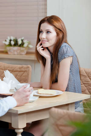 Lady talks with man sitting at the table at the restaurant Stock Photo - 15316356