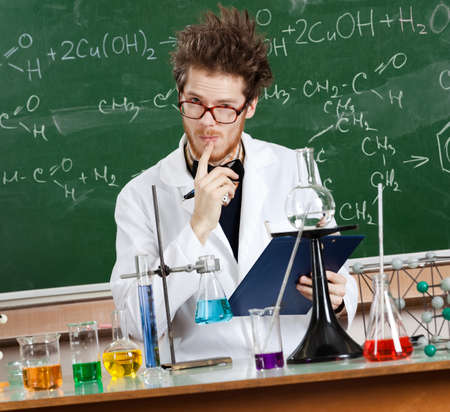 scientist in lab: Mad professor considers the results of tests in his laboratory Stock Photo