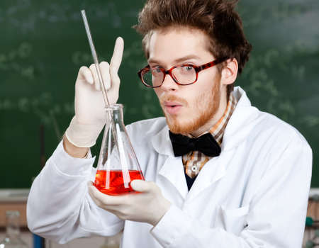 Crazy professor is in his laboratory photo