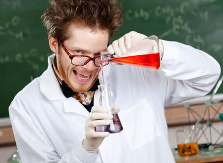 Crazy scientist mixes two liquids in his laboratory photo