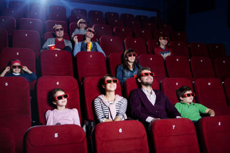 family movies: Smiling people in 3D movie theater