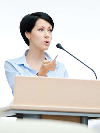 Female presenter at the podium. Business conference photo