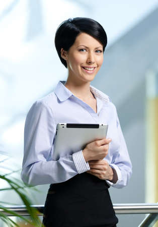 joy pad: Business woman with tablet at the business centre