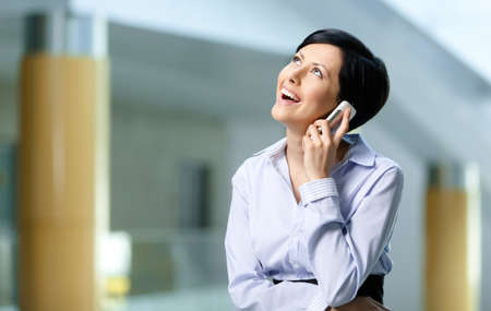 adult intercourse: Business woman in business suit talks on mobile. Communication