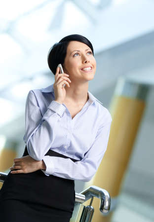 adult intercourse: Business woman in business suit talks on phone. Leadership