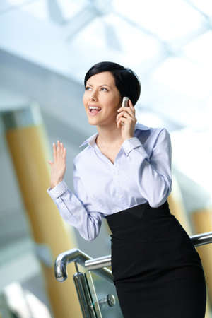 adult intercourse: Business woman in business suit talks on telephone. Communication