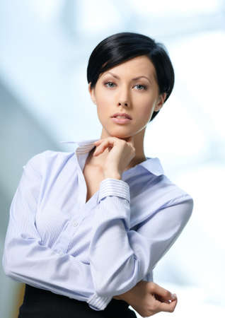 short skirt: Portrait of a handsome businesswoman wearing white shirt and black skirt at business centre Stock Photo