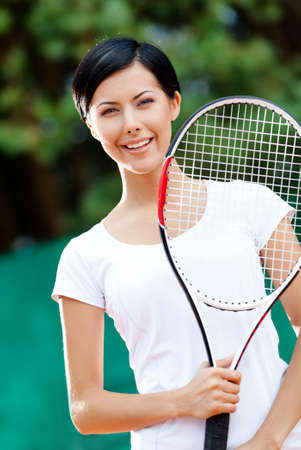 avocation: Portrait of young female tennis player with racket at the tennis court Stock Photo