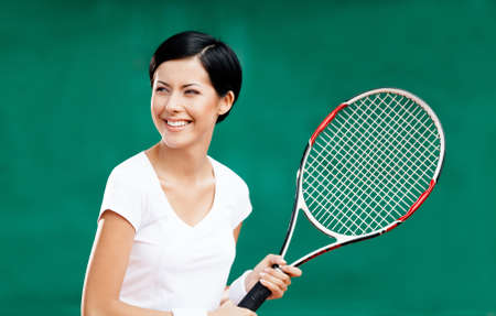 Portrait of female tennis player with racquet at the tennis court Stock Photo - 15316246