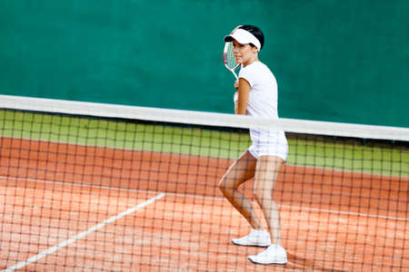 sports wear: Sportswoman at the tennis court with racquet. Match