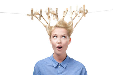 strange: Woman with creative haircut of clothes pegs, isolated on white