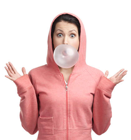 gums: Girl in sweatshirt blows out pink bubble gum, isolated on white