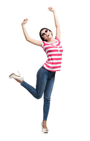 shot put: Happy dancing teenager with arms up, isolated on a white. Fashion