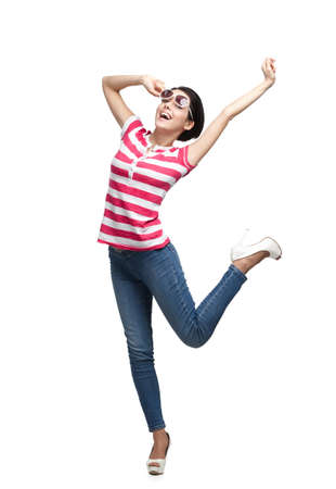 shot put: Happy dancing teenager with arms up, isolated on white background. Fashion