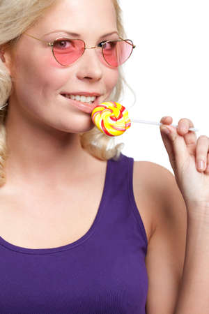 Woman in pink glasses with lollypop, isolated on white photo