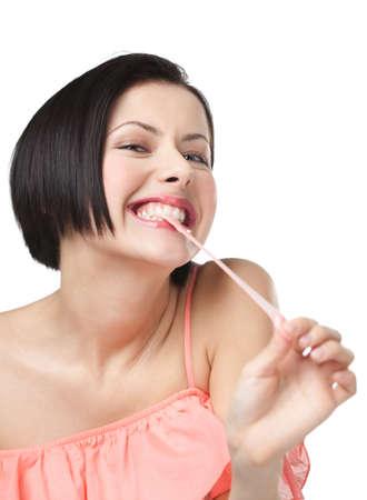 goma de mascar: Señora y goma de mascar, aislado en blanco