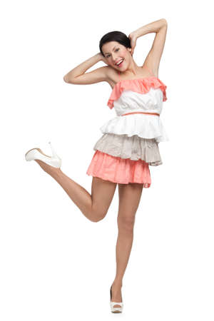 Dancing woman in colored dress, isolated on white photo