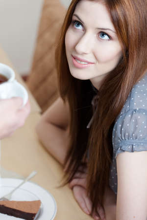 Lady and cup of tea at the restaurant Stock Photo - 15434066