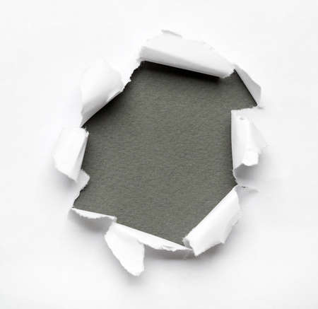 hole in wall: Grey circle shape breakthrough paper hole with white background