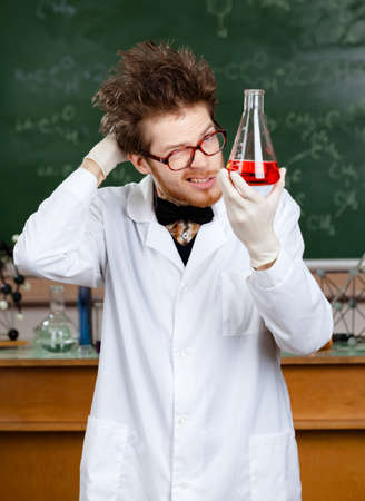 medical scientist: Mad professor holds Erlenmeyer flask with red liquid Stock Photo