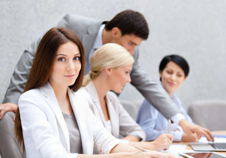 business shirt: Business people at the conference discuss current issues at the modern office building. Team Stock Photo