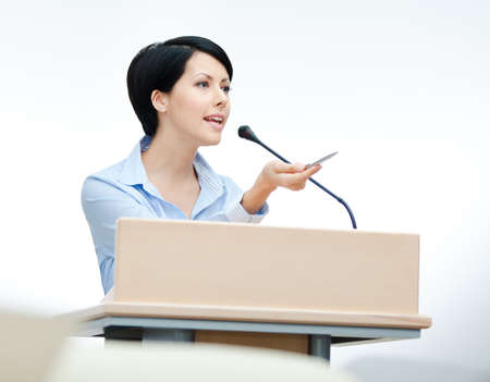 woman speaking: Female executive at the board. Business training