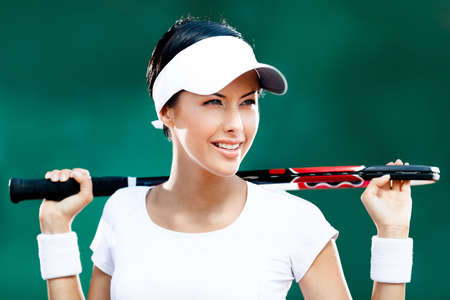 Beautiful sportswoman with racket at the tennis court. Healthy lifestyle Stock Photo - 15433317