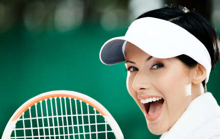 Close up of young female tennis player with towel on her shoulders Stock Photo - 15434030