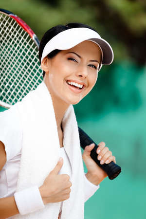 Successful female tennis player with towel on her shoulders. Active pastime Stock Photo - 15435161