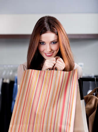 Woman hands paper bags photo