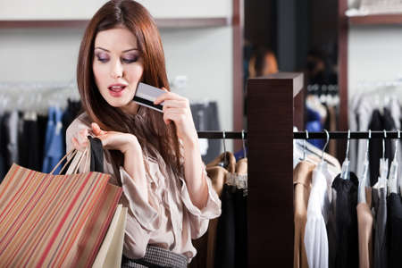 Young woman with credit card is in the shop Stock Photo