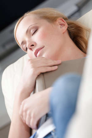 girl sit: Pretty woman fall asleep while reading a book Stock Photo