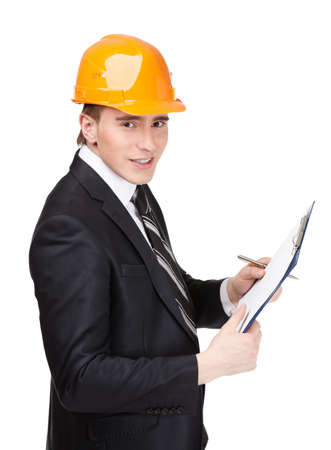 Making notes man in orange helmet and suit, isolated on white Stock Photo - 15530475