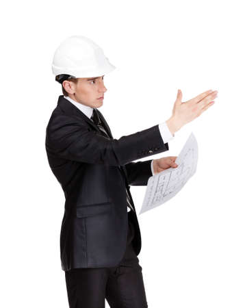 Businessman in white hard hat pointing at something hands blueprint, isolated on white Stock Photo - 15530462