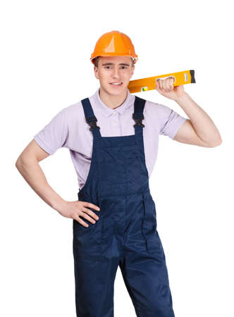 architecting: Contractor in orange hard cap hands engineers level, isolated on white Stock Photo