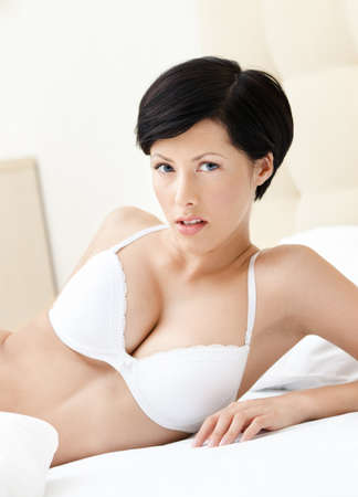 mystique: Beautiful woman in underwear is lying in the soft bed