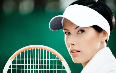 avocation: Close up of successful female tennis player with towel on her shoulders
