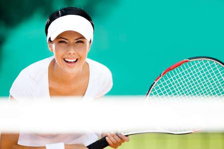 Woman in sportswear playing tennis. Tournament Stock Photo - 15530470