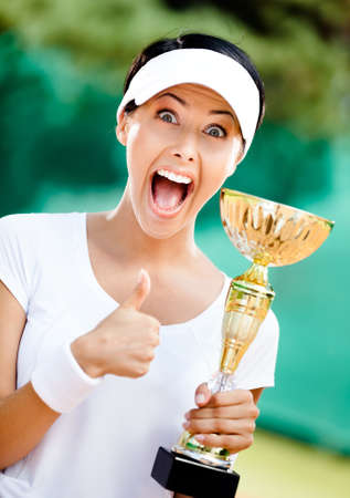 Tennis player won the cup at the sport match. Victory Stock Photo - 15530474