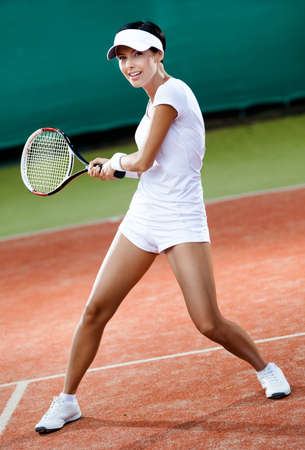 Tennis competition. Professional female player at the clay tennis court