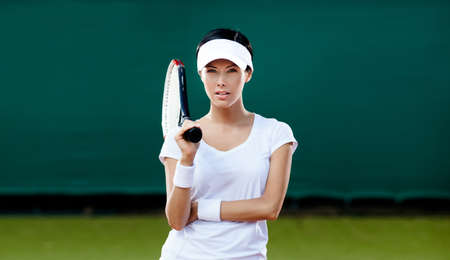 Tennis competition. Female player at the tennis court photo