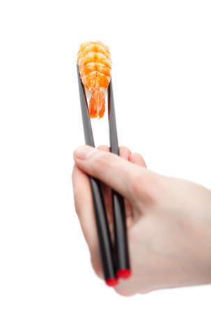 Hand holding sushi nigiri with chopsticks, isolated on white photo