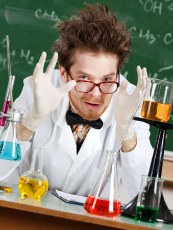 Gesturing a great amount mad professor is in his laboratory photo