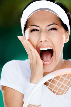 Close up of happy woman with tennis racquet at the tennis court  Trophy Stock Photo - 15647247