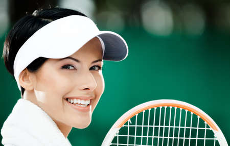 Close up of professional female tennis player with towel on her shoulders Stock Photo - 15647262