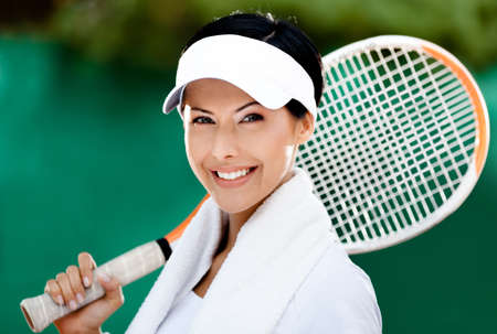 tennis racquet: Close up of tennis player with towel on her shoulders