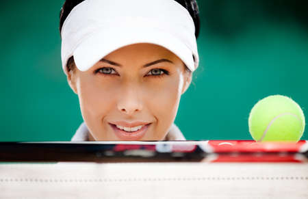 Close up of sporty woman with tennis racket and ball photo